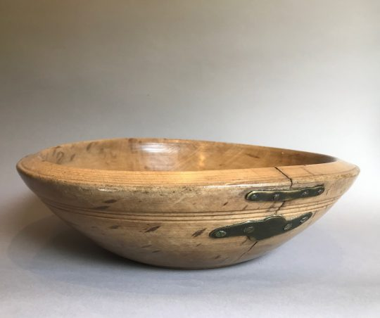 "Large turned Welsh sycamore dairy bowl with ""make do and mend"" repair. Sold"