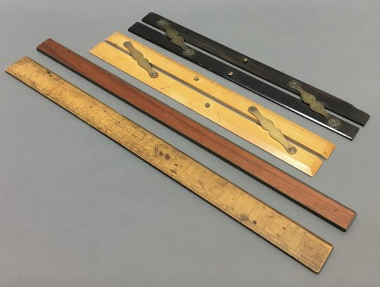 A collection of four rulers