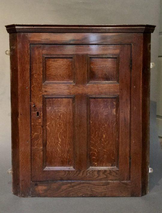 Welsh oak hanging corner cupboard