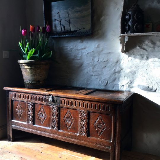A carved four panel oak chest Sold