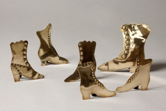 Collection of brass boots