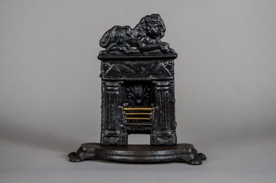 A miniature cast iron fire place Sold
