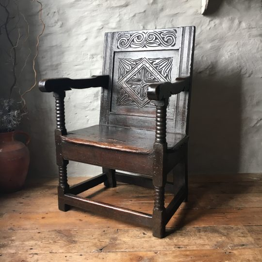 Carved 17th century armchair Sold
