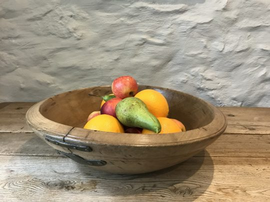 "Large turned Welsh sycamore dairy bowl with ""make do and mend"" repair."