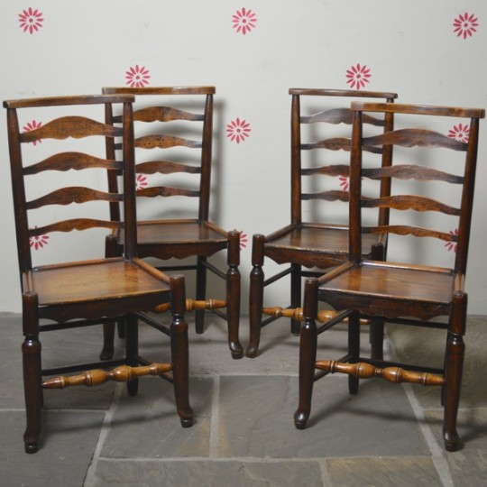 Set of four ladder-back chairs. Sold