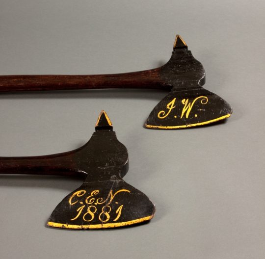 A pair of wooden ceremonial axes Sold