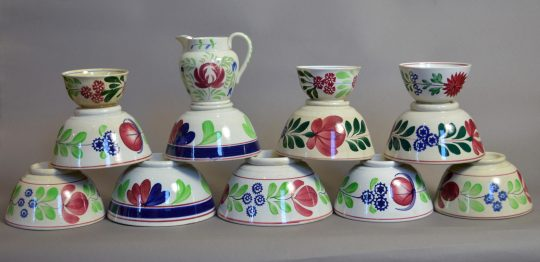 Hand painted and sponge decorated pottery