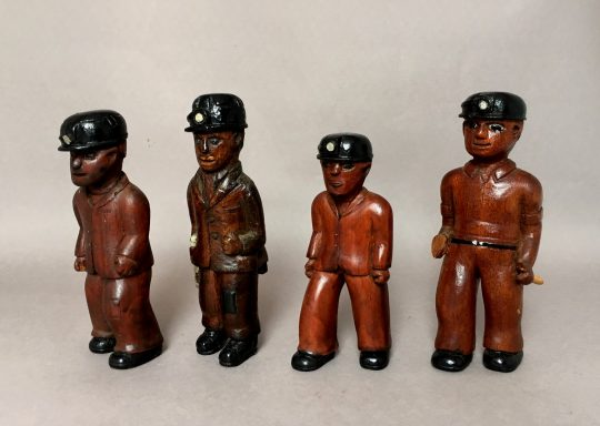 Collection of carved Welsh folk art miners Sold
